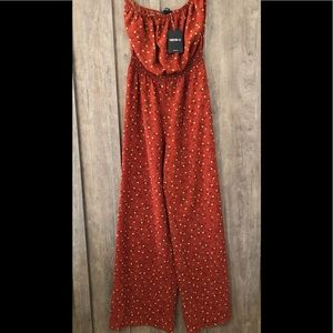 rust orange floral jumpsuit •new with tags• size S